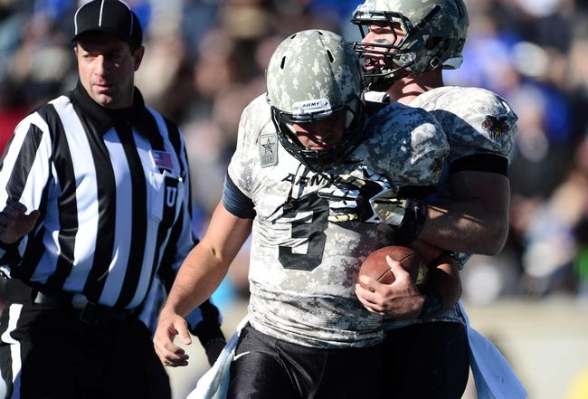 Nov 2, 2013; Colorado Springs, CO, USA; Army Black Knights quarterback Angel Santiago (3) is congratulated for his touchdown run by wide receiver Patrick Laird (81) in the first quarter against the Air Force Falcons at Falcon Stadium. Mandatory Credit: Ron Chenoy-USA TODAY Sports