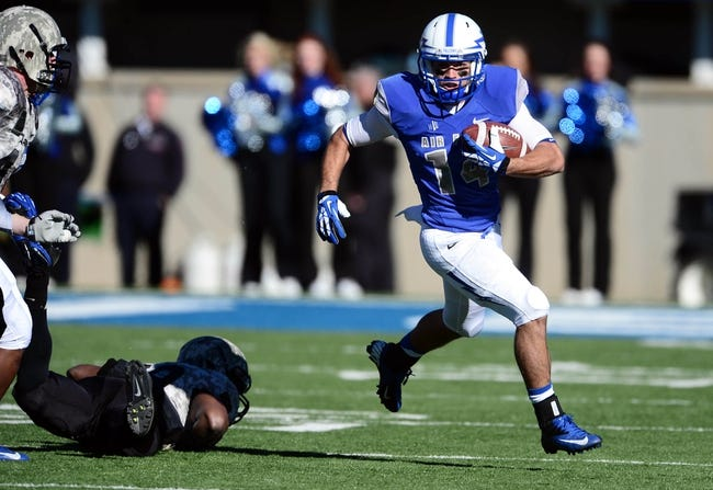 Nov 2, 2013; Colorado Springs, CO, USA; Air Force Falcons wide receiver Colton Huntsman (14) runs after a reception in the first quarter against the Army Black Knights at Falcon Stadium. Mandatory Credit: Ron Chenoy-USA TODAY Sports