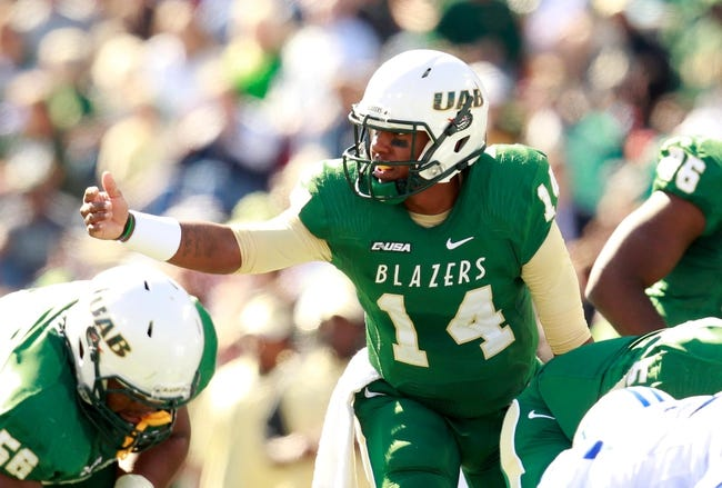 Nov 2, 2013; Birmingham, AL, USA; UAB Blazers quarterback Jonathan Perry (14) directs the offense against Middle Tennessee State Blue Raiders at Legion Field. Mandatory Credit: Marvin Gentry-USA TODAY Sports
