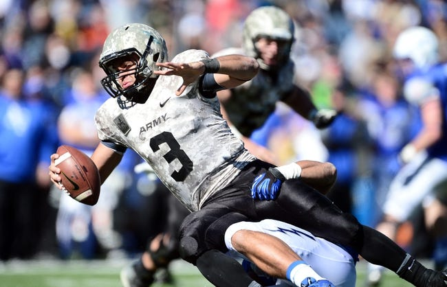 Nov 2, 2013; Colorado Springs, CO, USA; Army Black Knights quarterback Angel Santiago (3) is sacked by Air Force Falcons linebacker Jordan Pierce (51) in the fourth quarter at Falcon Stadium. The Falcons defeated the Black Knights 42-28. Mandatory Credit: Ron Chenoy-USA TODAY Sports