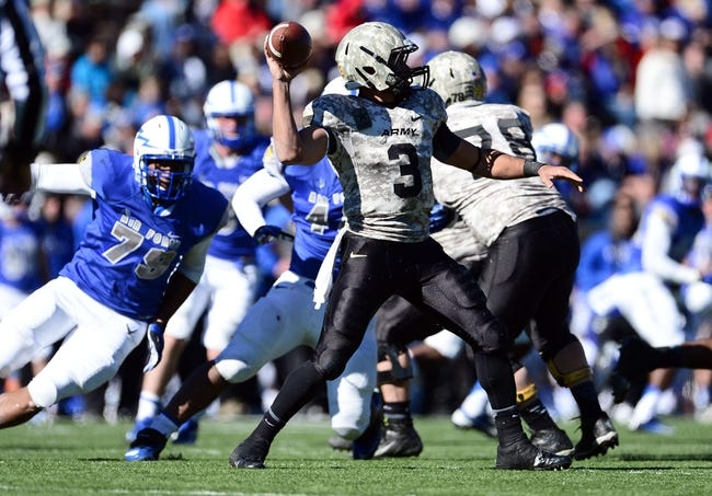 Nov 2, 2013; Colorado Springs, CO, USA; Army Black Knights quarterback Angel Santiago (3) prepares to pass in the fourth quarter against the Air Force Falcons at Falcon Stadium. The Falcons defeated the Black Knights 42-28. Mandatory Credit: Ron Chenoy-USA TODAY Sports