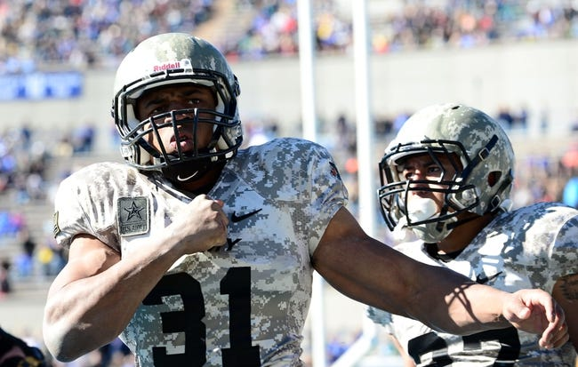 Nov 2, 2013; Colorado Springs, CO, USA; Army Black Knights running back Terry Baggett (31) reacts to his touchdown run in the fourth quarter against the Air Force Falcons at Falcon Stadium. The Falcons defeated the Black Knights 42-28. Mandatory Credit: Ron Chenoy-USA TODAY Sports
