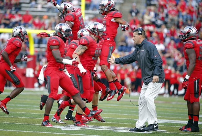 Nov 2, 2013; Piscataway, NJ, USA;  Rutgers Scarlet Knights defensive line coach Jim Panagos celebrates with players on an Temple Owls turnover during the second half at High Points Solutions Stadium. Rutgers Scarlet Knights defeat the Temple Owls 23-20. Mandatory Credit: Jim O'Connor-USA TODAY Sports