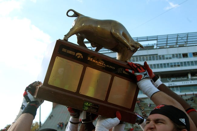 Nov 2, 2013; Iowa City, IA, USA; The Wisconsin Badgers share the Heartland Trophy with fans after their win against the Iowa Hawkeyes at Kinnick Stadium.  Wisconsin beat Iowa 28-9.  Mandatory Credit: Reese Strickland-USA TODAY Sports