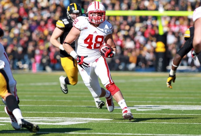 Nov 2, 2013; Iowa City, IA, USA;  Wisconsin Badgers tight end Jacob Pedersen (48) runs after the catch against the Iowa Hawkeyes at Kinnick Stadium.  Wisconsin beat Iowa 28-9.  Mandatory Credit: Reese Strickland-USA TODAY Sports