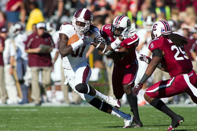 Nov 2, 2013; Columbia, SC, USA;Mississippi State Bulldogs wide receiver De'Runnya Wilson (81) runs after catching a pass during the fourth quarter against the South Carolina Gamecocks at Williams-Brice Stadium. The Gamecocks defeated the Bulldogs 34-16.  Mandatory Credit: Jeremy Brevard-USA TODAY Sports