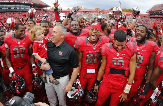 Nov 2, 2013; Piscataway, NJ, USA;  Rutgers Scarlet Knights head coach Kyle Flood celebrates with son Joseph Flood and the players after the game against the Temple Owls at High Points Solutions Stadium. Rutgers won 23-20. Mandatory Credit: Jim O'Connor-USA TODAY Sports