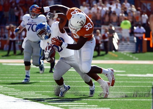 Nov 2, 2013; Austin, TX, USA; Kansas Jayhawks halfback James Sims (29) is tackled by Texas Longhorns linebacker Steve Edmond (33) during the first quarter at Darrell K Royal-Texas Memorial Stadium. Mandatory Credit: Brendan Maloney-USA TODAY Sports