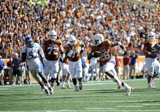 Nov 2, 2013; Austin, TX, USA;  Texas Longhorns tailback Malcolm Brown (28) runs the ball against the Kansas Jayhawks during the second quarter at Darrell K Royal-Texas Memorial Stadium. Mandatory Credit: Brendan Maloney-USA TODAY Sports
