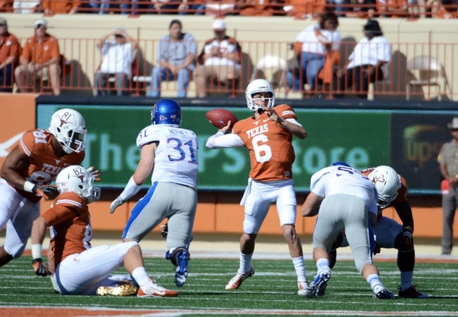 Nov 2, 2013; Austin, TX, USA; Texas Longhorns quarterback Case McCoy (6) passes the ball against the Kansas Jayhawks during the first quarter at Darrell K Royal-Texas Memorial Stadium. Mandatory Credit: Brendan Maloney-USA TODAY Sports