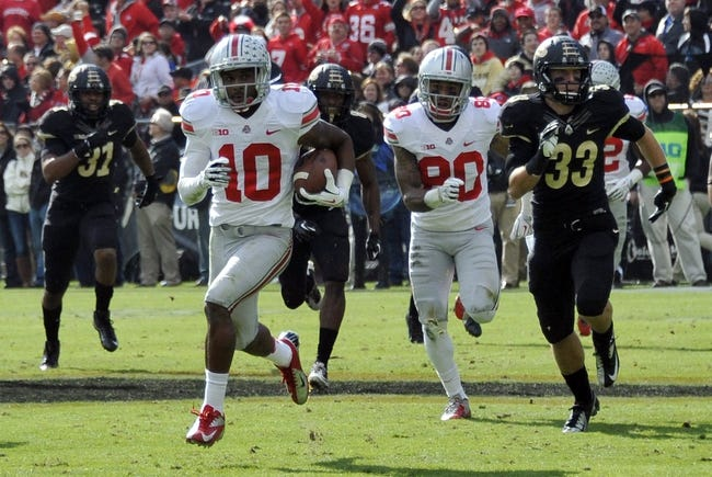 Nov 2, 2013; West Lafayette, IN, USA;  Ohio State Buckeyes wide receiver Philly Brown (10) runs with the ball as he is chased in the first half against the Purdue Boilermakers at Ross Ade Stadium. Mandatory Credit: Sandra Dukes-USA TODAY Sports