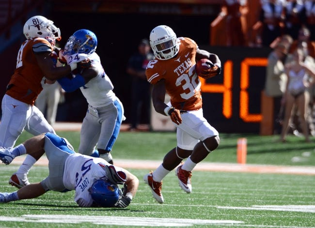 Nov 2, 2013; Austin, TX, USA; Texas Longhorns running back Johnathan Gray (32) avoids a tackle against the Kansas Jayhawks during the second quarter at Darrell K Royal-Texas Memorial Stadium. Mandatory Credit: Brendan Maloney-USA TODAY Sports