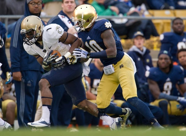 Nov 2, 2013; South Bend, IN, USA; Navy Midshipmen cornerback Brendon Clements (1) intercepts a pass intended for Notre Dame Fighting Irish wide receiver DaVaris Daniels (10) in the second quarter at Notre Dame Stadium. Mandatory Credit: Matt Cashore-USA TODAY Sports