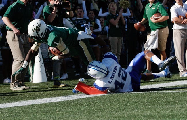 Nov 2, 2013; Birmingham, AL, USA;  UAB Blazers wide receiver Jamarcus Nelson (1) scores in the fourth quarter as Middle Tennessee State Blue Raiders safety Xavier Walker (42) chases him down at Legion Field. The Blue Raiders defeat the Blazers 24-21. Mandatory Credit: Marvin Gentry-USA TODAY Sports