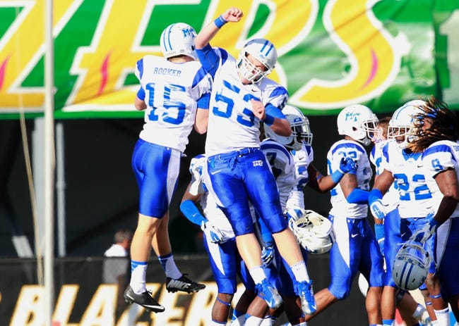 Nov 2, 2013; Birmingham, AL, USA;  Middle Tennessee State Blue Raiders kicker Canon Rooker (15) along with snapper William Eads (53) celebrate defeating the UAB Blazers at Legion Field. The Blue Raiders defeat the Blazers 24-21. Mandatory Credit: Marvin Gentry-USA TODAY Sports
