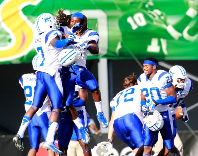 Nov 2, 2013; Birmingham, AL, USA;  Middle Tennessee State Blue Raiders wide receiver Kyle Griswold (9) celebrates winning the game with cornerback Khari Burke (7) after defeating the UAB Blazers at Legion Field. The Blue Raiders defeat the Blazers 24-21. Mandatory Credit: Marvin Gentry-USA TODAY Sports