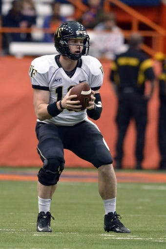 Nov 2, 2013; Syracuse, NY, USA; Wake Forest Demon Deacons quarterback Tanner Price (10) drops back to pass during the third quarter of a game against the Syracuse Orange at the Carrier Dome. Syracuse won the game 13-0. Mandatory Credit: Mark Konezny-USA TODAY Sports