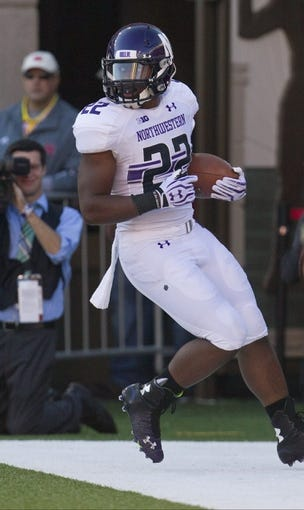 Nov 2, 2013; Lincoln, NE, USA; Northwestern Wildcats running back Treyvon Green (22) scores a touchdown against the Nebraska Cornhuskers in the second quarter at Memorial Stadium. Mandatory Credit: Bruce Thorson-USA TODAY Sports