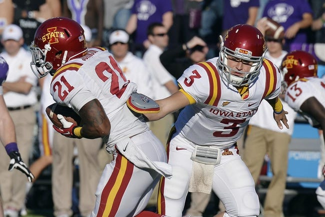 Nov 2, 2013; Manhattan, KS, USA; Iowa State Cyclones quarterback Grant Rohach (3) hands there ball off to  running back Shontrelle Johnson (21) against the Kansas State Wildcats during the second half at Bill Snyder Family Stadium. The Wildcats defeat the Cyclones 41-7. Mandatory Credit: Jasen Vinlove-USA TODAY Sports