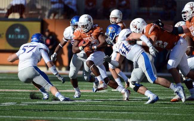 Nov 2, 2013; Austin, TX, USA; Texas Longhorns running back Johnathan Gray (28) runs the ball against the Kansas Jayhawks during the third quarter at Darrell K Royal-Texas Memorial Stadium. Texas beat Kansas 35-13. Mandatory Credit: Brendan Maloney-USA TODAY Sports