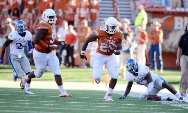 Nov 2, 2013; Austin, TX, USA; Texas Longhorns running back Malcolm Brown (38) runs the ball against the Kansas Jayhawks during the fourth quarter at Darrell K Royal-Texas Memorial Stadium. Texas beat Kansas 35-13. Mandatory Credit: Brendan Maloney-USA TODAY Sports