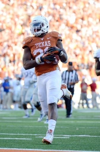 Nov 2, 2013; Austin, TX, USA; Texas Longhorns running back Malcolm Brown (38) scores a touchdown against the Kansas Jayhawks during the fourth quarter at Darrell K Royal-Texas Memorial Stadium. Texas beat Kansas 35-13. Mandatory Credit: Brendan Maloney-USA TODAY Sports