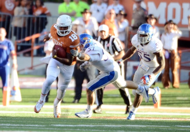 Nov 2, 2013; Austin, TX, USA; Texas Longhorns quarterback Tyrone Swoopes (18) runs the ball against the Kansas Jayhawks during the fourth quarter at Darrell K Royal-Texas Memorial Stadium. Texas beat Kansas 35-13. Mandatory Credit: Brendan Maloney-USA TODAY Sports