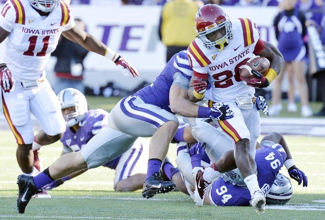 Nov 2, 2013; Manhattan, KS, USA; Iowa State Cyclones running back DeVondrick Nealy (20) is tackled by Kansas State Wildcats linebacker Jonathan Truman (21) during the second half at Bill Snyder Family Stadium. The Wildcats defeat the Cyclones 41-7. Mandatory Credit: Jasen Vinlove-USA TODAY Sports