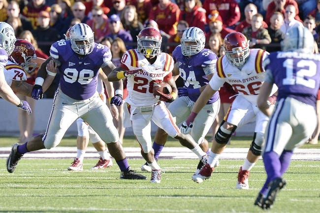 Nov 2, 2013; Manhattan, KS, USA; Iowa State Cyclones running back DeVondrick Nealy (20) runs the ball against the Kansas State Wildcats during the second half at Bill Snyder Family Stadium. The Wildcats defeat the Cyclones 41-7. Mandatory Credit: Jasen Vinlove-USA TODAY Sports