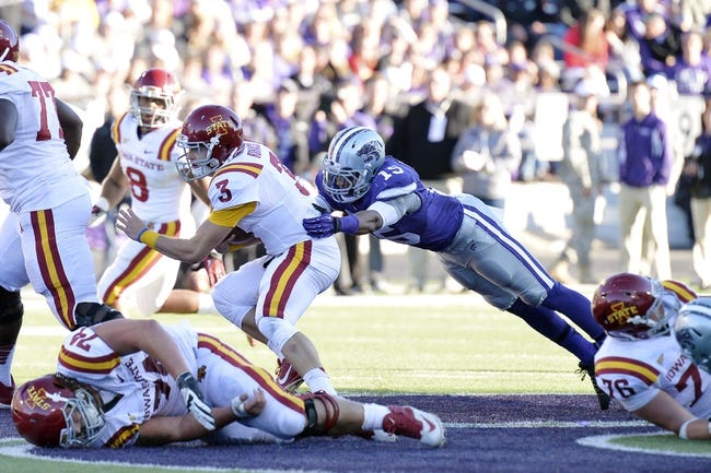 Nov 2, 2013; Manhattan, KS, USA; Kansas State Wildcats defensive back Randall Evans (15) tackles Iowa State Cyclones quarterback Grant Rohach (3) during the second half at Bill Snyder Family Stadium. The Wildcats defeat the Cyclones 41-7. Mandatory Credit: Jasen Vinlove-USA TODAY Sports