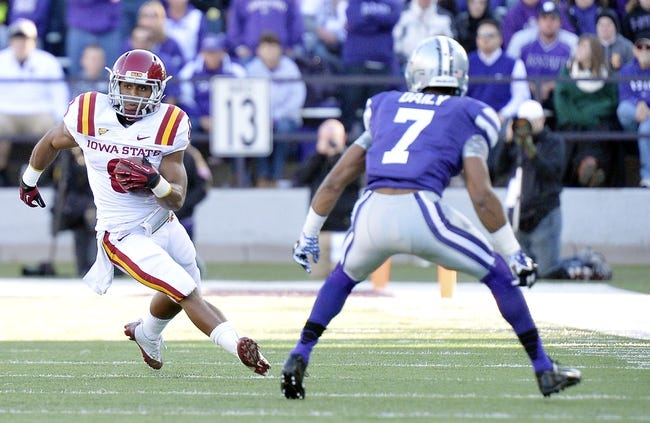 Nov 2, 2013; Manhattan, KS, USA; Iowa State Cyclones running back James White (8) runs the ball while being defended by Kansas State Wildcats defensive back Kip Daily (7) during the second half at Bill Snyder Family Stadium. The Wildcats defeat the Cyclones 41-7. Mandatory Credit: Jasen Vinlove-USA TODAY Sports