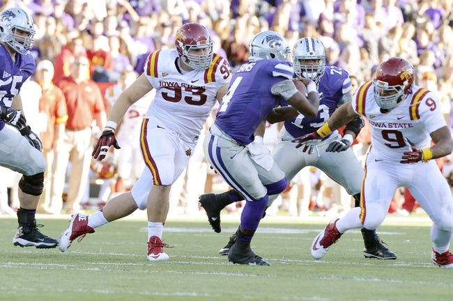 Nov 2, 2013; Manhattan, KS, USA; Iowa State Cyclones defensive lineman Brandon Jensen (93) pressures Kansas State Wildcats quarterback Daniel Sams (4) during the second half at Bill Snyder Family Stadium. The Wildcats defeat the Cyclones 41-7. Mandatory Credit: Jasen Vinlove-USA TODAY Sports