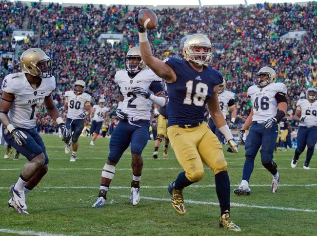 Nov 2, 2013; South Bend, IN, USA; Notre Dame Fighting Irish tight end Ben Koyack (18) celebrates after scoring a touchdown in front of Navy Midshipmen cornerback Brandon Clements (1) and cornerback Parrish Gaines (2) in the third quarter at Notre Dame Stadium. Notre Dame won 38-34. Mandatory Credit: Matt Cashore-USA TODAY Sports