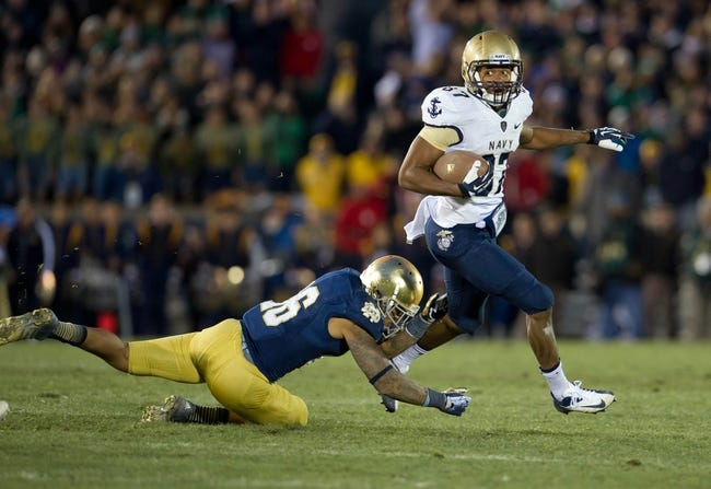 Nov 2, 2013; South Bend, IN, USA; Navy Midshipmen wide receiver Shawn Lynch (87) carries the ball as Notre Dame Fighting Irish safety Eilar Hardy (16) attempts to tackle in the fourth quarter at Notre Dame Stadium. Notre Dame won 38-34. Mandatory Credit: Matt Cashore-USA TODAY Sports
