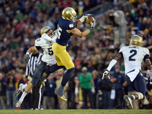 Nov 2, 2013; South Bend, IN, USA; Notre Dame Fighting Irish tight end Troy Niklas (85) catches a pass for a first down in front of Navy Midshipmen linebacker Cody Peterson (53) in the fourth quarter at Notre Dame Stadium. Notre Dame won 38-34. Mandatory Credit: Matt Cashore-USA TODAY Sports
