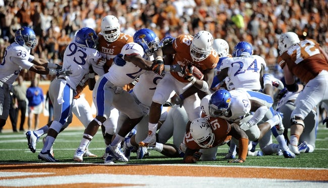 Nov 2, 2013; Austin, TX, USA; Texas Longhorns running back Malcolm Brown (28) scores a touchdown against the Kansas Jayhawks during the second quarter at Darrell K Royal-Texas Memorial Stadium. Texas beat Kansas 35-13. Mandatory Credit: Brendan Maloney-USA TODAY Sports