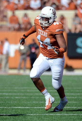 Nov 2, 2013; Austin, TX, USA; Texas Longhorns defensive end Jackson Jeffcoat (44) against the Kansas Jayhawks during the first quarter at Darrell K Royal-Texas Memorial Stadium. Texas beat Kansas 35-13. Mandatory Credit: Brendan Maloney-USA TODAY Sports