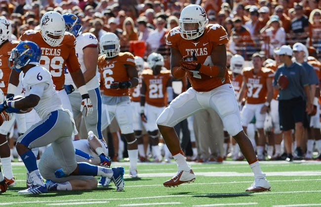 Nov 2, 2013; Austin, TX, USA; Texas Longhorns defensive end Jackson Jeffcoat (44) reacts against the Kansas Jayhawks during the second quarter at Darrell K Royal-Texas Memorial Stadium. Texas beat Kansas 35-13. Mandatory Credit: Brendan Maloney-USA TODAY Sports
