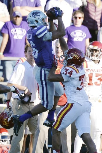 Nov 2, 2013; Manhattan, KS, USA; Kansas State Wildcats tight end Andre McDonald (18) catches pass while being defended by Iowa State Cyclones defensive back Nigel Tribune during the second half at Bill Snyder Family Stadium. The Wildcats defeat the Cyclones 41-7. Mandatory Credit: Jasen Vinlove-USA TODAY Sports