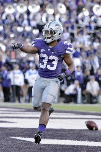 Nov 2, 2013; Manhattan, KS, USA; Kansas State Wildcats running back John Hubert (33) points at the fans after scoring a touchdown against the Iowa State Cyclones during the second half at Bill Snyder Family Stadium. The Wildcats defeat the Cyclones 41-7. Mandatory Credit: Jasen Vinlove-USA TODAY Sports