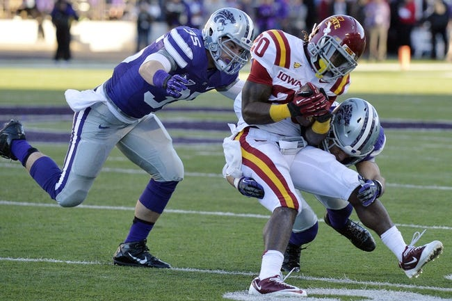 Nov 2, 2013; Manhattan, KS, USA; Kansas State Wildcats defensive back Ty Zimmerman (12) and linebacker Will Davis (35) tackle Iowa State Cyclones running back DeVondrick Nealy (20) during the second half at Bill Snyder Family Stadium. The Wildcats defeat the Cyclones 41-7. Mandatory Credit: Jasen Vinlove-USA TODAY Sports