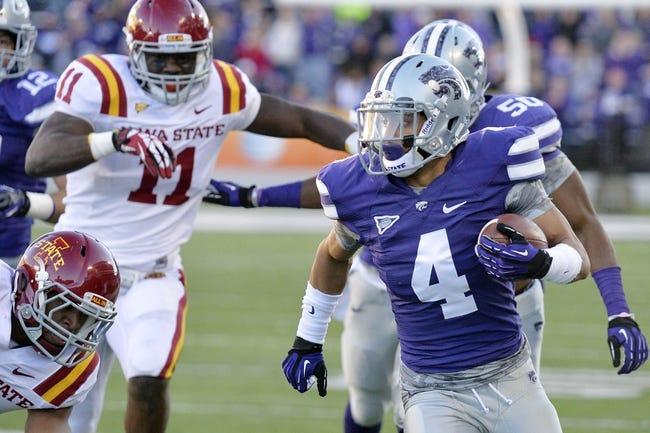 Nov 2, 2013; Manhattan, KS, USA; Kansas State Wildcats defensive back Dorrian Roberts (4) runs the ball after intercepting a pass against the Iowa State Cyclones during the second half at Bill Snyder Family Stadium. The Wildcats defeat the Cyclones 41-7. Mandatory Credit: Jasen Vinlove-USA TODAY Sports