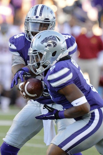Nov 2, 2013; Manhattan, KS, USA; Kansas State Wildcats quarterback Daniel Sams (4) hands the ball off to running back Robert Rose (5) against the Iowa State Cyclones during the second half at Bill Snyder Family Stadium. The Wildcats defeat the Cyclones 41-7. Mandatory Credit: Jasen Vinlove-USA TODAY Sports