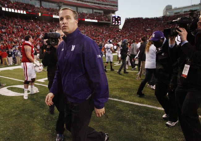Nov 2, 2013; Lincoln, NE, USA; Northwestern Wildcats head coach Pat Fitzgerald leaves the field after losing on the last play of the game to the Nebraska Cornhuskers in at Memorial Stadium. Nebraska won 27-24. Mandatory Credit: Bruce Thorson-USA TODAY Sports