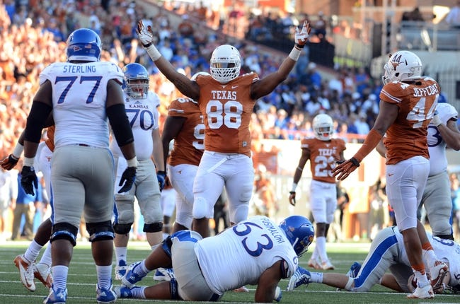 Nov 2, 2013; Austin, TX, USA; Texas Longhorns defensive end Cedric Reed (44) reacts against the Kansas Jayhawks during the fourth quarter at Darrell K Royal-Texas Memorial Stadium. Texas beat Kansas 35-13. Mandatory Credit: Brendan Maloney-USA TODAY Sports