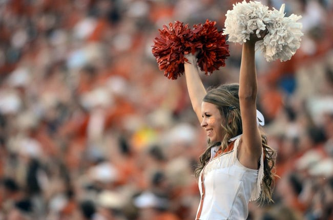 Nov 2, 2013; Austin, TX, USA; A Texas Longhorns cheerleader reacts against the Kansas Jayhawks during the fourth quarter at Darrell K Royal-Texas Memorial Stadium. Texas beat Kansas 35-13. Mandatory Credit: Brendan Maloney-USA TODAY Sports