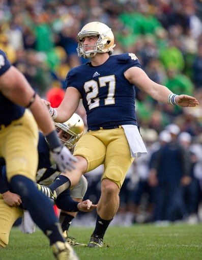 Nov 2, 2013; South Bend, IN, USA; Notre Dame Fighting Irish kicker Kyle Brindza (27) kicks an extra point in the first quarter against the Navy Midshipmen at Notre Dame Stadium. Notre Dame won 38-34. Mandatory Credit: Matt Cashore-USA TODAY Sports
