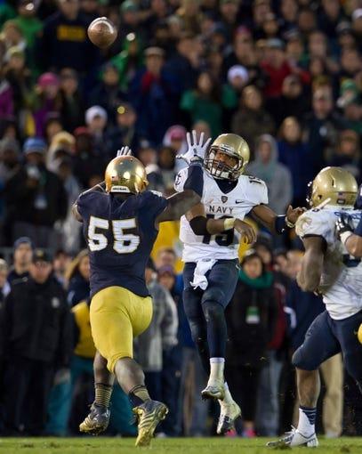 Nov 2, 2013; South Bend, IN, USA; Navy Midshipmen quarterback Keenan Reynolds (19) throws under pressure from Notre Dame Fighting Irish linebacker Prince Shembo (55) in the fourth quarter at Notre Dame Stadium. Notre Dame won 38-34. Mandatory Credit: Matt Cashore-USA TODAY Sports