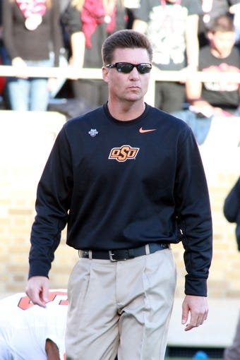Nov 2, 2013; Lubbock, TX, USA; Oklahoma State Cowboys head coach Mike Gundy before the game with the Texas Tech Red Raiders at Jones AT&T Stadium. Mandatory Credit: Michael C. Johnson-USA TODAY Sports