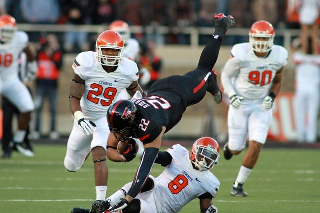 Nov 2, 2013; Lubbock, TX, USA; Texas Tech Red Raiders wide receiver Jace Amaro (22) catches a pass against the Oklahoma State Cowboys in the first quarter at Jones AT&T Stadium. Mandatory Credit: Michael C. Johnson-USA TODAY Sports